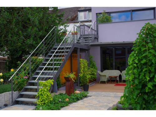 Steel staircase with stainless steel railing